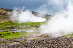 Geothermal valley with steam near Hveragerdi, thermal springs, Iceland. Geothermal valley with steam springs and thunder sky near Hveragerdi, thermal springs Royalty Free Stock Image