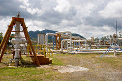 Geothermal well 3. Active geothermal wells that supply steam to a power facility stock images