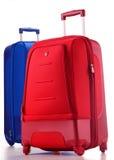 Gepäck, das aus den Koffern getrennt auf Weiß besteht Lizenzfreies Stockfoto