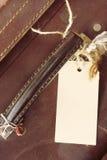 Gepäck-Kennsatz auf Weinlese-Koffer Stockfotos