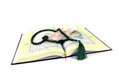 Gepeitschter Quran mit Afghani Lizenzfreies Stockbild
