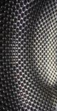 Geperforeerd roestvrij staal, textuur of metaalachtergrond stock foto
