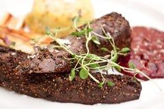 Gepfeffertes Steak Stockbilder