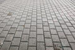 Gepflasterte Kopfsteinpflasterung Stockbilder