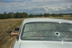 Geplänkel, Verfolgung und Schießen auf Auto Stockfotografie