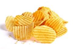 Geplätscherte Kartoffelchips Stockfotos