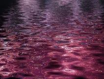 Geplätscherter purpurroter Auszug lizenzfreie stockbilder