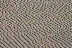 Geplätscherter Sandhintergrund Lizenzfreie Stockbilder