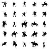 Geplaatste cowboysilhouetten Stock Afbeelding