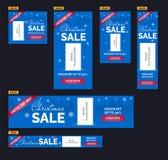 Geplaatste de banners van de Kerstmisverkoop Blauwe achtergrond, sneeuwvlokken, bomen, beeldplaceholder Stock Foto