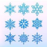 Geplaatste de pictogrammen van de sneeuwvlok Het symbool van de Kerstmisvakantie Sneeuw voor verwezenlijking van Nieuwjaar artist Stock Fotografie