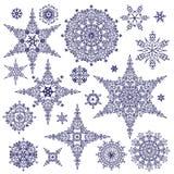 Geplaatste silhouetsneeuwvlokken De winter Vectorkrabbels Stock Foto