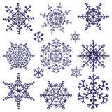 Geplaatste silhouetsneeuwvlokken De winterkrabbels Vector Royalty-vrije Stock Foto