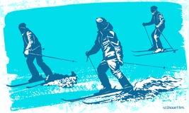 Geplaatste skiërssilhouetten Stock Afbeeldingen