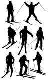 Geplaatste skiërssilhouetten Stock Afbeelding