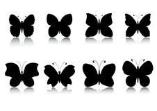 Geplaatste vlinderssilhouetten Stock Foto's
