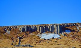 Gerðuberg Cliffs, hexagonal rock formations in iceland. A whole cliff made of these natural formations. Beautiful on a sunny day Royalty Free Stock Images