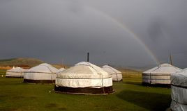 Ger camp in Mongolia. A rainbow over a tourist ger camp outside the walls of Amarbayasgalant Monastery in northern Mongolia Stock Image