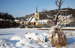Gera city in winter. Scenic view of Gera city in winter with snow covered park or field in foreground, Untermhaus, Thuringia, Germany Stock Photography
