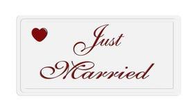 Gerade geheiratet auf einer weißen Platte Stockbild