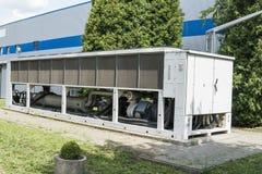 Gerador alternativo grande do gás natural para a construção de casa exterior imagem de stock