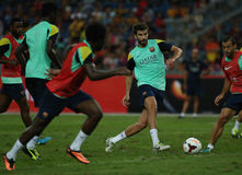 Gerald Pique. KUALA LUMPUR - AUGUST 09: Barcelona Football Club player Gerald Pique passes the ball during training session at the Bukit Jalil National Stadium Stock Photos