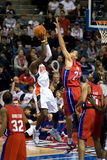 Gerald Wallace Shoots Over Tayshaun Prince. Gerald Wallace of the Charlotte Bobcats shoots over Tayshaun Prince during a game against the Detroit Pistons at the Stock Images