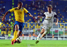 Geraldo Alves and Ben Davies in Petrolul Ploiesti-Swansea FC. Petrolul's Geraldo Alves and Swansea's Ben Davies pictured in action during the Europa League play Stock Image