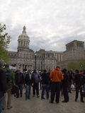Geraldo Rivera in Baltimore. BALTIMORE, MD - MAY 1, 2015: Geraldo Rivera strolls in front of City Hall in Baltimore, MD, surrounded by television news crews Stock Image
