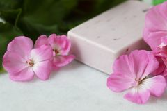 Geranium Flower Soap. Pink bar of soap with bright pink geranium flowers royalty free stock photography