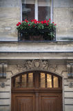 Flowers above an old door, Paris, France Stock Photography