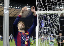 Gerard Pique. Pique of Barcelona cuts down the net of the goal after the 2015 UEFA Champions League Final between Juventus Torino from Italy and FC Barcelona Royalty Free Stock Photo