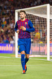 Gerard Pique of FC Barcelona. BARCELONA - AUGUST 17: Gerard Pique in action during the Spanish Super Cup final match between FC Barcelona and Real Madrid, 3 - 2 Royalty Free Stock Images