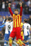 Gerard Pique of FC Barcelona. Celebrates a goal during a Spanish League match against RCD Espanyol at the Estadi Cornella on March 29, 2014 in Barcelona, Spain Stock Photo