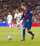 Gerard Pique. Of FCB in action at the Spanish Super Cup final match between FC Barcelona and Real Madrid, 3 - 2, on August 17, 2011 in Camp Nou stadium Royalty Free Stock Photos