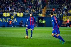 Gerard Pique plays at the La Liga match between Villarreal CF and FC Barcelona. VILLARREAL, SPAIN - JAN 8: Gerard Pique plays at the La Liga match between Royalty Free Stock Photos