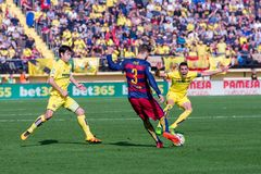 Gerard Pique plays at the La Liga match between Villarreal CF and FC Barcelona. VILLARREAL, SPAIN - MAR 20: Gerard Pique plays at the La Liga match between Stock Images