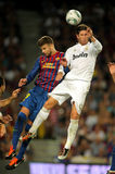 Gerard Pique vies with Sergio Ramos Stock Image
