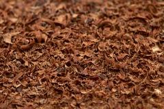 Geraspt 100 percenten als achtergrond van de cacao donkere chocolade Stock Afbeeldingen