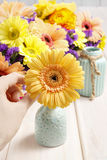Gerbera flower in ceramic vase. Party decoration Stock Images