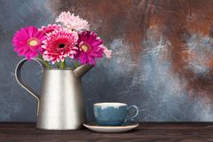 Gerbera flowers bouquet and coffee cup Stock Image