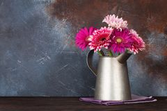 Gerbera flowers bouquet. Gerbera flowers in front of stone wall. With space for your text Royalty Free Stock Images