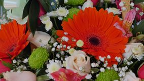 Gerbera, tulips and mix of summer flowers bouquet for the wedding.  stock footage