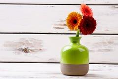 Gerberas in ceramic vase. Royalty Free Stock Photos