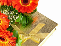 Gerberas with giftbox Stock Images
