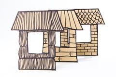 Gerecycleerde karton gemaakte huizen Stock Afbeeldingen