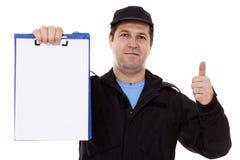 Gereifter Mann, der unten am whiteboard lokalisiert über Weiß anzeigt Lizenzfreies Stockfoto