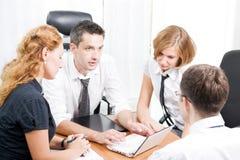 Gerente com os trabalhadores de escritório na reunião Imagem de Stock Royalty Free