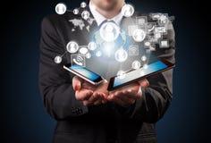 Gerente com tecnologias Foto de Stock Royalty Free