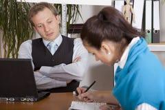 Gerente e secretária infelizes Fotografia de Stock Royalty Free